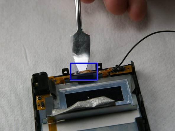 Carefully remove the wireless assembly that runs along the top and upper left edges of the Zune.
