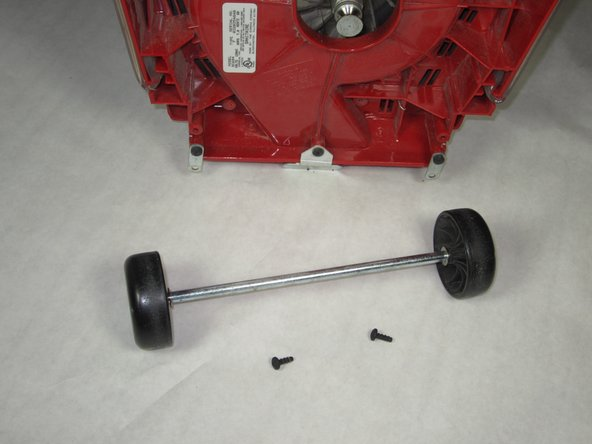 Pull the wheel's axle towards you and replace back wheels.