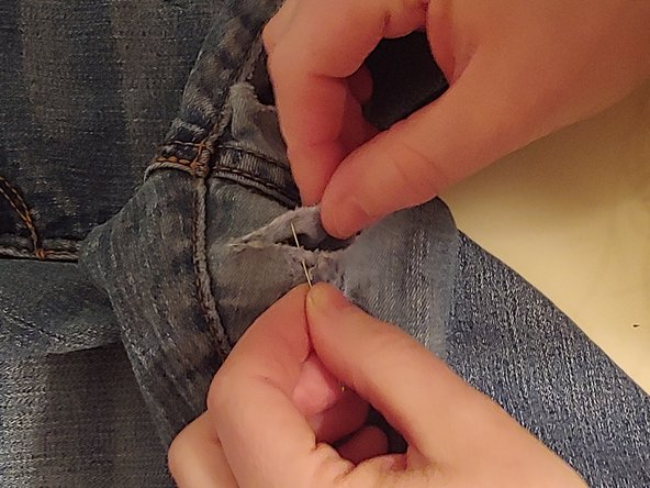 Use a simple back and forth pattern with the needle and thread to close the holes.