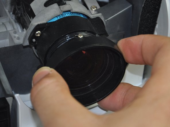 Remove the focal lens by twisting it clockwise until it comes off.