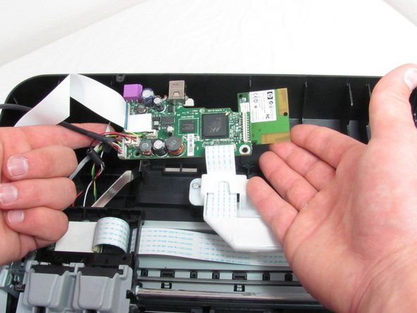 Gently lift motherboard out of the slot.