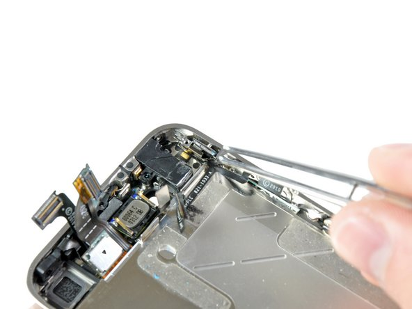 Use a pair of tweezers to carefully pull the silent switch and its bracket from the side of the outer case.