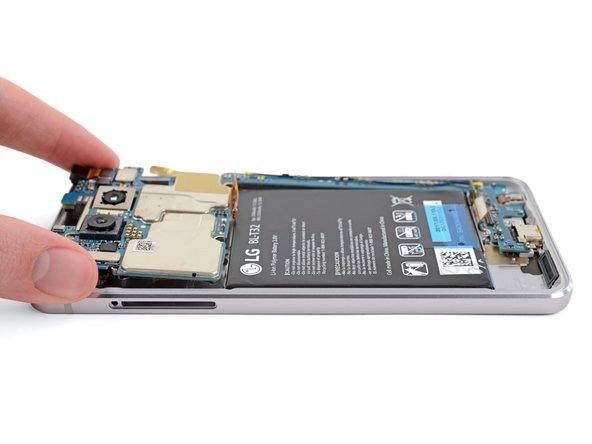 Grab the motherboard by the top end (the end with the cameras) and gently lift it up and out of the phone.