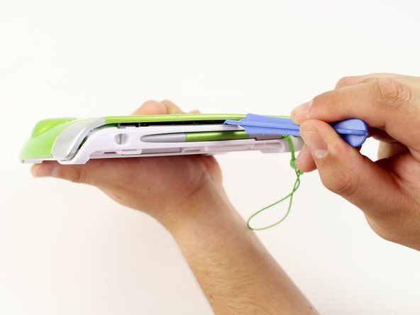 Insert a plastic opening tool into the seam between the front and rear covers to detach the back cover from the rest of the device.