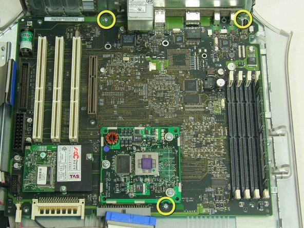 Unfasten 3 Phillips screws revealed beneath the heat sink on the CPU board.