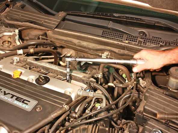 If the spark plug doesn't need to be replaced, return it to the spark plug bore. If it does need to be replaced, use a new one.
