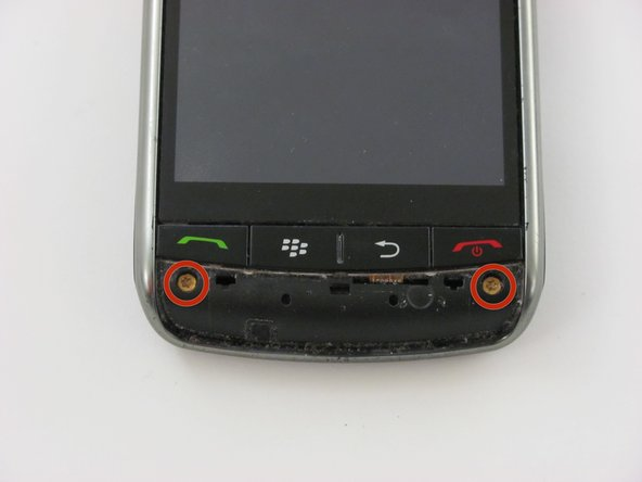 Remove the two bronze Torx T6 3 mm screws below the red and green phone symbols.