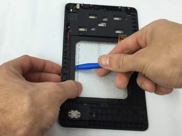 To remove the LCD panel, flip the device over and detach the LCD digitizer cable from the frame if they have become stuck together.