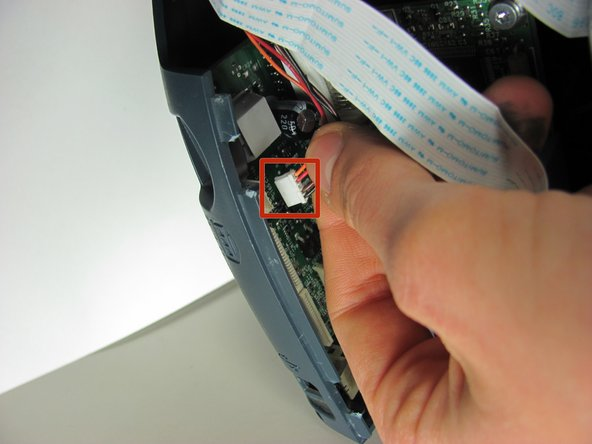 Unplug the white plastic multi-wire connector with the orange, black, red, and brown wires from it's port.
