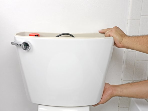 Lift the tank up from the lower half of the toilet.