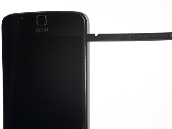 Slide the spudger along the side of the phone until you get to the clip securing the display to the rear case.