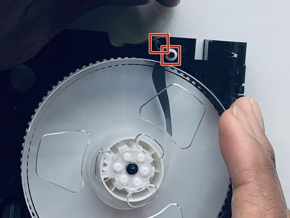 Place the right reel into the replacement shell, making sure the tape goes in-between metal and  plastic circular pieces here.
