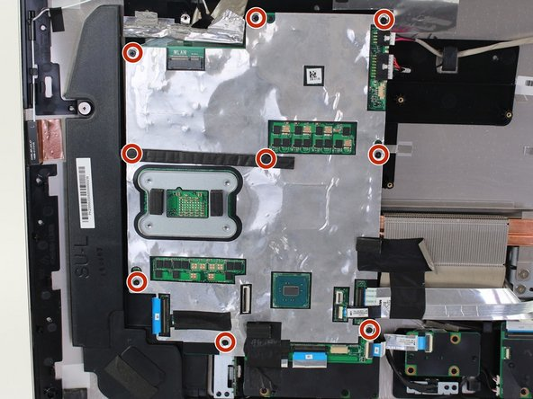 Use a Phillips #1 screwdriver to remove nine (9) 3.2 mm screws from the motherboard.