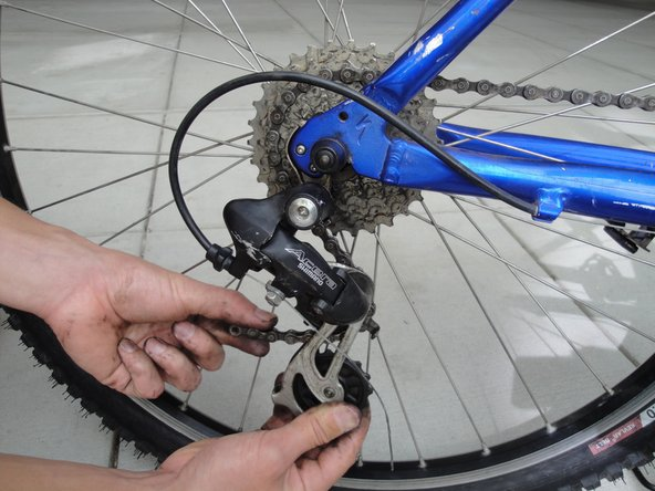 Route the chain around the chain rings, cassette, and derailleur.