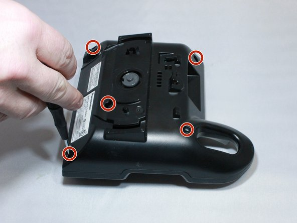 Remove back by unscrewing the 5 screws at the corners and in the middle of the charging base using a small Phillips screwdriver,.
