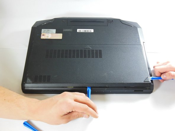 Close the lid of the laptop and flip it over so that the battery faces away from you.