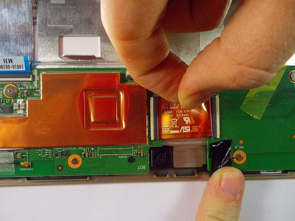 Remove black tape from ribbon cable and separate the cable from the soundboard.
