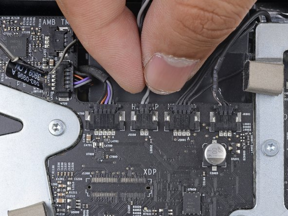 If your motherboard has a socket for a hard drive temperature sensor, follow this step to plug the sensor wires in.