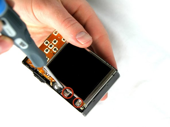 Remove the two 2.4 mm screws located at the top of the LCD panel.