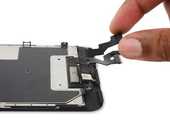 Remove the FaceTime camera and sensor assembly.