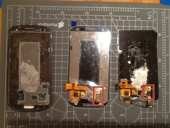 Comparing a new display (in the centre) against the old one (on right) and the case (on left)