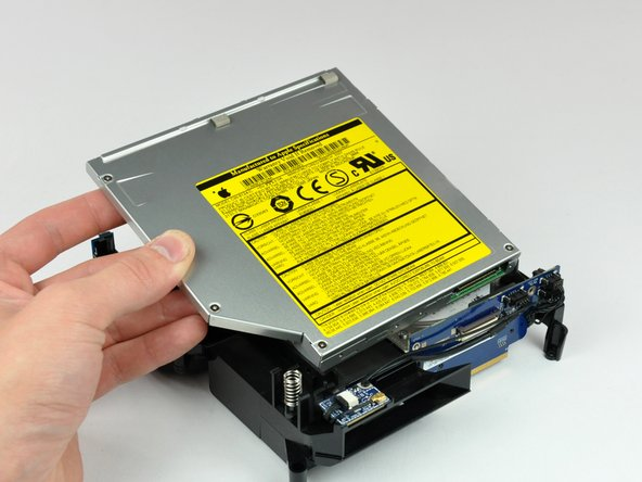 Lift the optical drive out of the internal frame.
