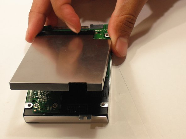 Remove the upper and lower casing from the hard drive.