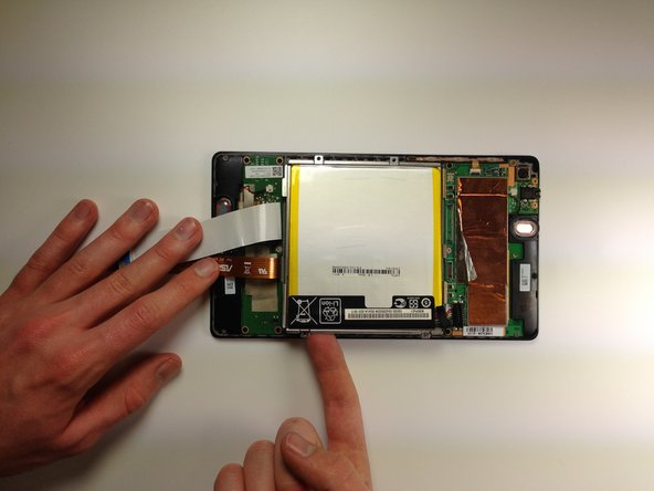 Remove the battery from your device by applying pressure at the base of the battery and lifting it out.