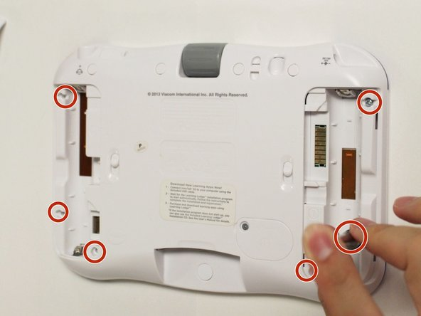 Remove six 7 mm #1 screws from the interior of the battery compartment.