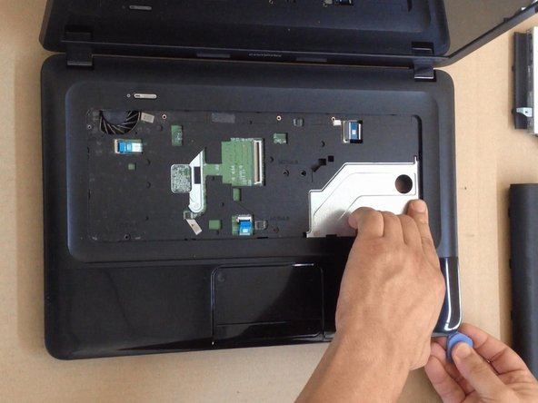 Use a plastic tool to separate and remove the upper case.