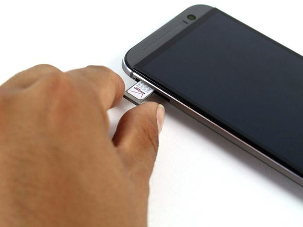 Remove the SIM card tray assembly from the HTC One M8.