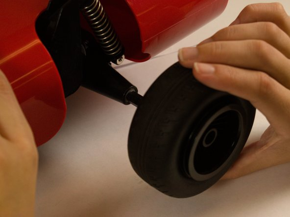 After removing the 11 mm screw, firmly grip the wheel and pull away from the vehicle.