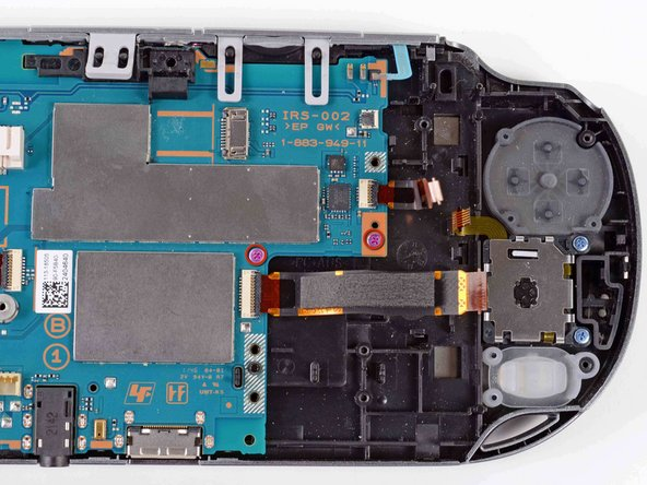 Using a Phillips #00 screwdriver, remove the two pink, 4.4mm screws securing the motherboard.