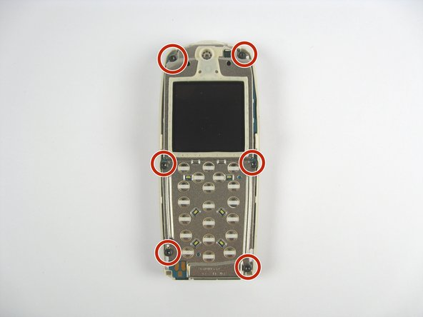 Remove the six screws along the edges of the phone.