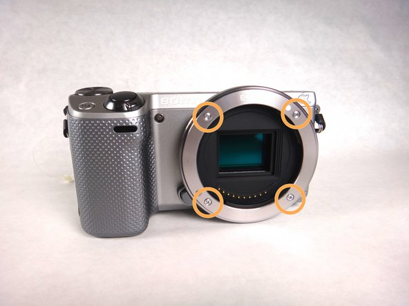 Using your screwdriver, remove the four (3.5 mm) Phillips screws on the front face of the lens mount.