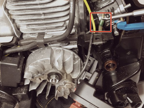 Using a flat head screw driver disconnect the (primer-side) fuel line from the carburetor.