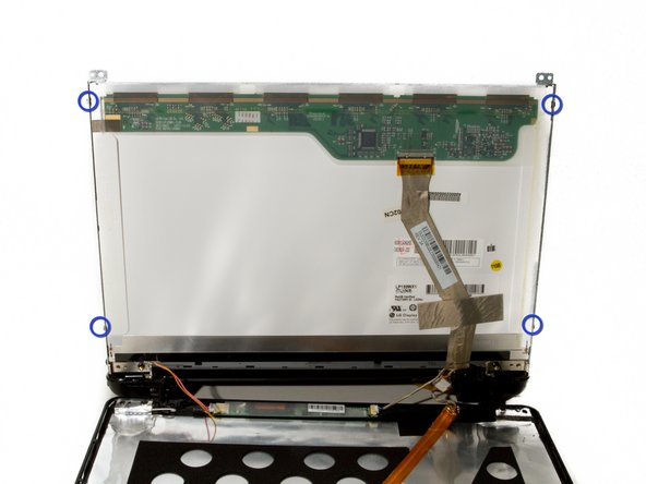 Locate and remove the four 2mm #1 Phillips screws around the sidewalls of the display.