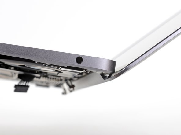 Lift the MacBook and carefully rotate the display to a 90 degree angle with the upper case.