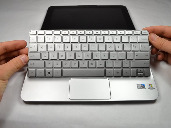 Remove the keyboard by lifting it away from the computer.