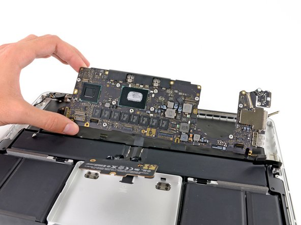 And just like that, out comes the logic board.
