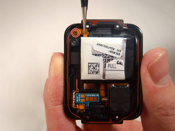 Use a pair of tweezers to peel the battery ribbon cable off of the back cover.