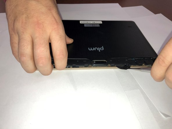Use a metal spudger to begin lifting the back cover.