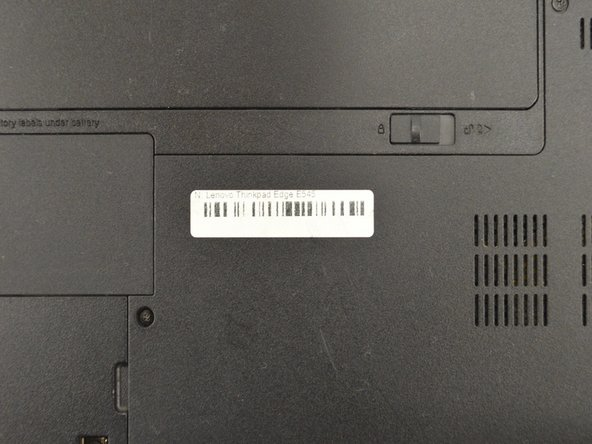 First, flip the laptop over as shown in the photo.