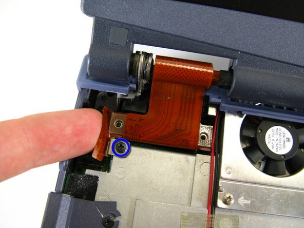 Remove the black screw with your Phillips screwdriver.