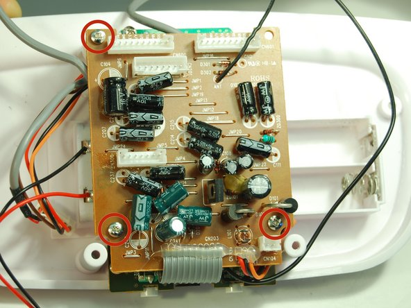 Use the Phillips #1 Screwdriver to remove the three 8 mm screws holding the motherboard in place.