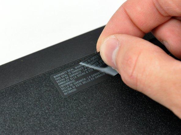 De-warranty-izing and de-tabbing on the underside of the Slim ensues...
