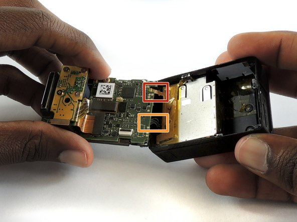 Using tweezers, remove the ribbon strip by pulling on it. This will remove the connection.