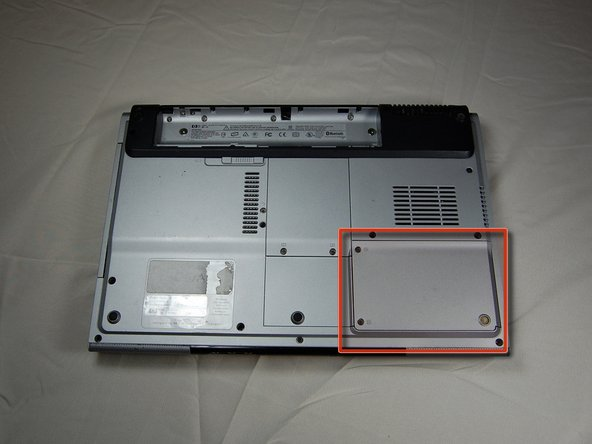 With the battery removed, locate the hard drive access panel.