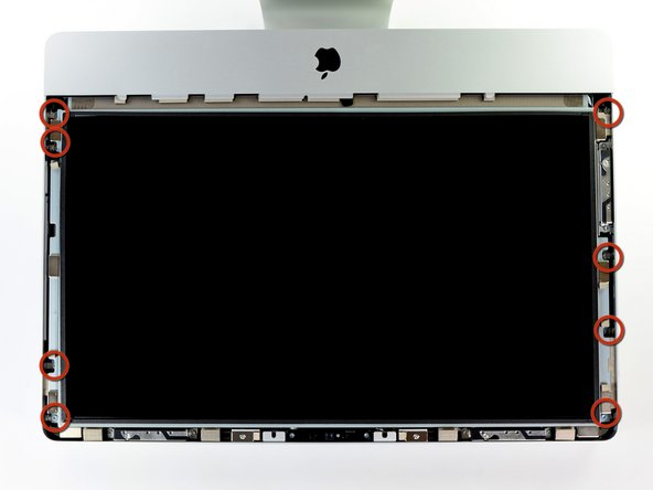 Remove the eight 8 mm T10 Torx screws securing the display to the outer case.