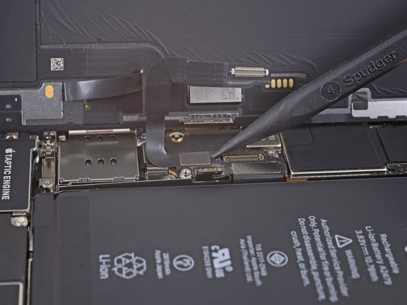 Use a spudger or a fingernail to disconnect the digitizer cable connector.